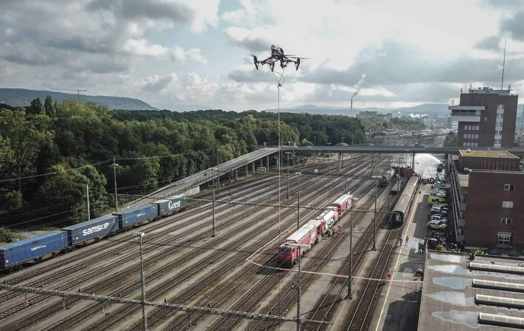Tethered drone for railway surveillance