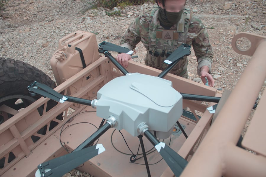 Vehicle mounted surveillance tethered drone